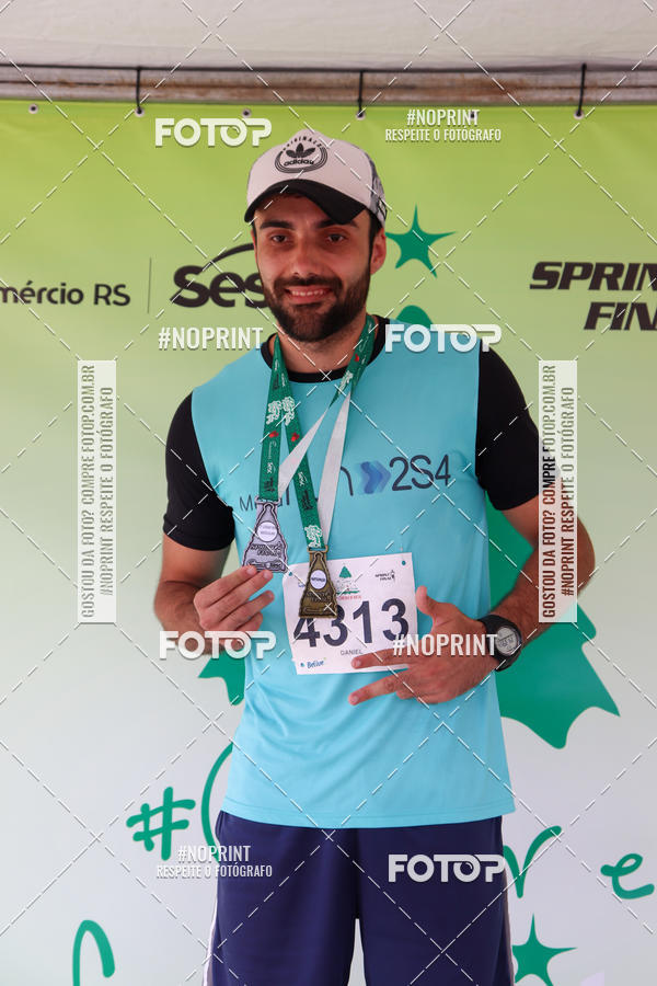 Buy your photos at this event 7ª Corrida de Natal de Porto Alegre on Fotop