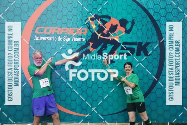 Buy your photos at this event Corrida Noturna 5k Aniversario de São Vicente on Fotop
